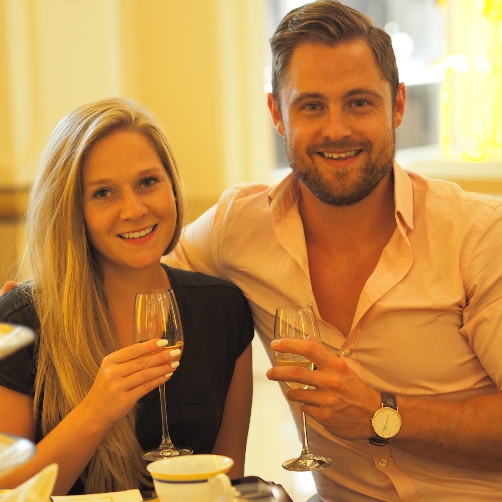 Couple sipping champagne at Afternoon Tea, The Lobby, Peninsula Hotel, Hong Kong