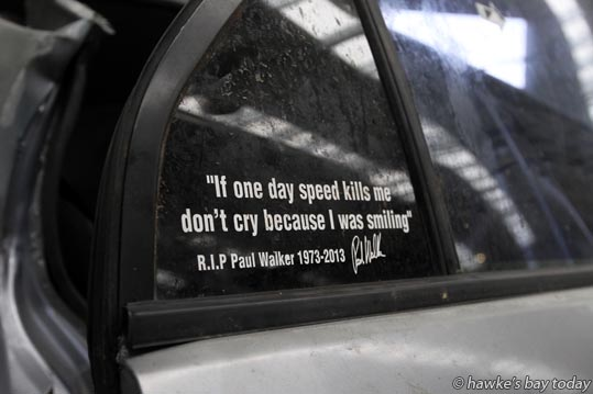 """ ""If one day speed kills me, don't cry because I was smiling"" R.I.P Paul Walker 1973-2013"" - written on a Mitsubishi Lancer Evolution IV commonly known as an Evo 4, a car in which a person died in a fatal accident on Farndon Rd, Hastings, last week. Pictured at Hawke's Bay Towing, Whakatu, Hastings. photograph"