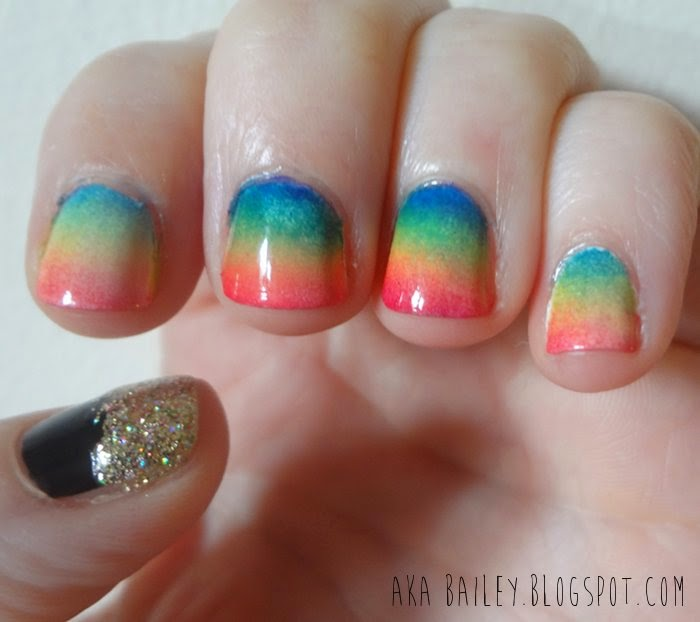 Rainbow sponged gradient nail polish, with a pot of gold accent nail
