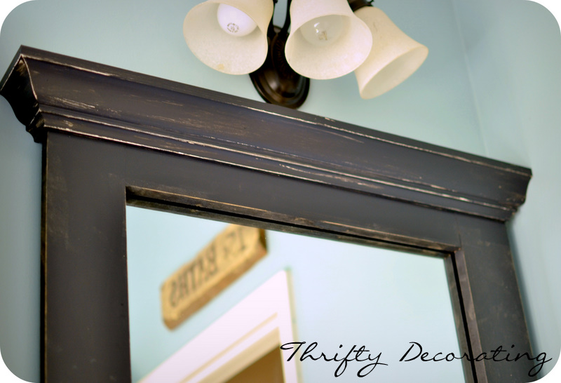 Thrifty Decorating: Frame Your Bathroom Mirror