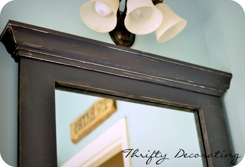 Thrifty decorating frame your bathroom mirror for How to frame mirror in bathroom