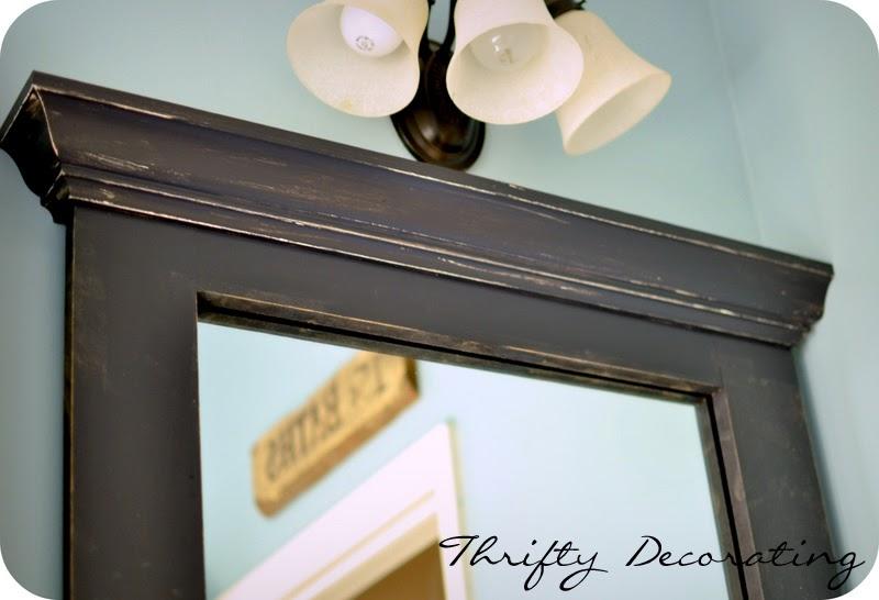 thrifty decorating frame your bathroom mirror. Black Bedroom Furniture Sets. Home Design Ideas