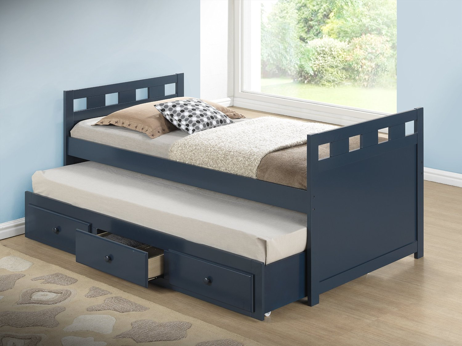 Twin bed with pull out slide out trundle bed underneath for Compact beds