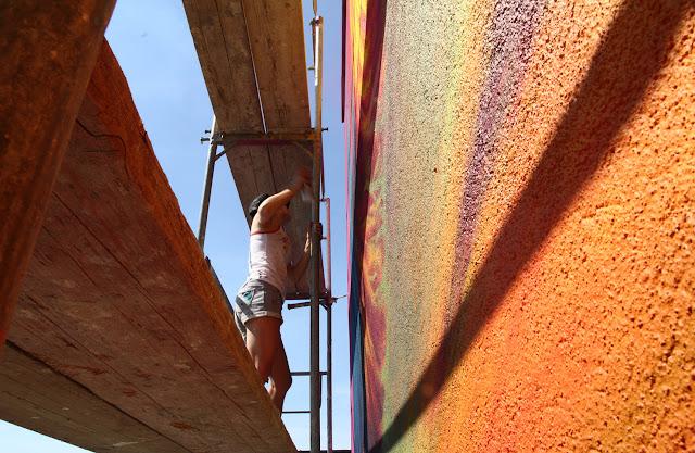 street artist natalia rak at work in poland