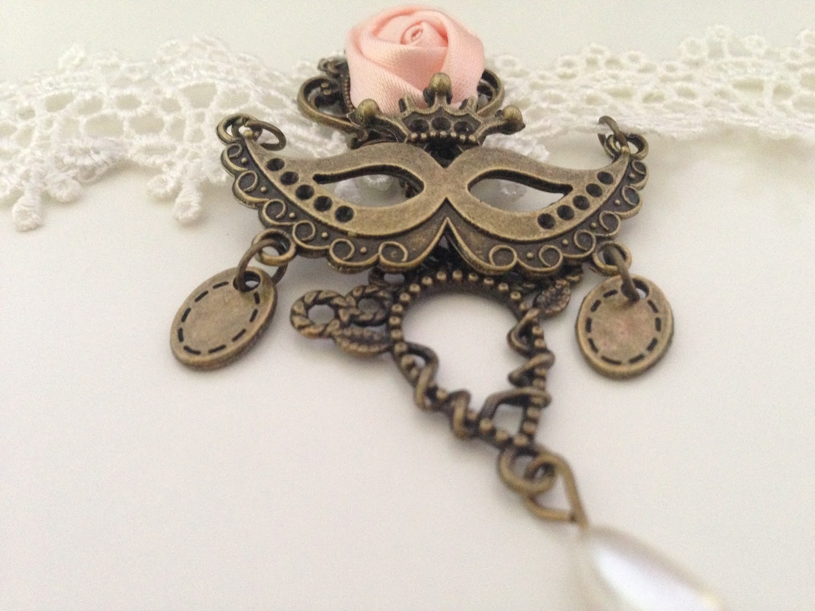 More photos of Born Pretty Store's lolita-style white lace choker necklace, featuring a pink rose and alloy mask.