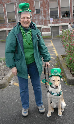 Heidi with yellow Lab in St Patricks Day garb