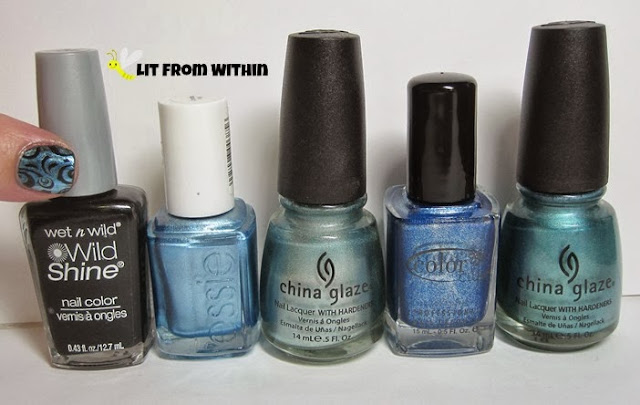 Bottle shot:  Wet 'n Wild Black Creme, Essie Blue Rhapsody, China Glaze Metallic Muse, Color Club unlabeled blue metallic, and China Glaze Adore