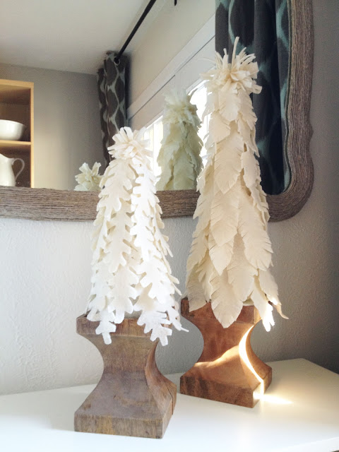 Homemade, DIY felted Christmas trees made to look like Wisteria Nesting Felt Trees