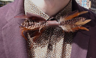 Brown multi pheasant feather on brown bowtie from TOPMAN.