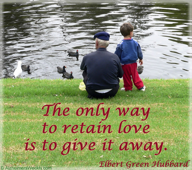 "Grandson and grandchild by ducks on a river, with the saying, ""The only way to retain love is to give it away."""