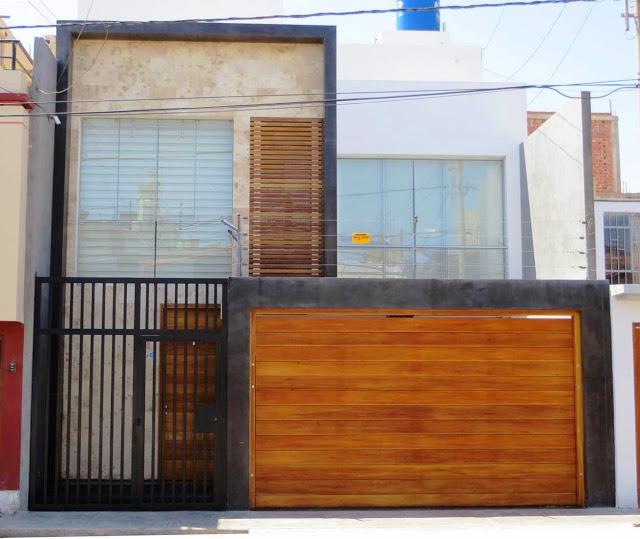 Moderna casa de dos pisos con cochera
