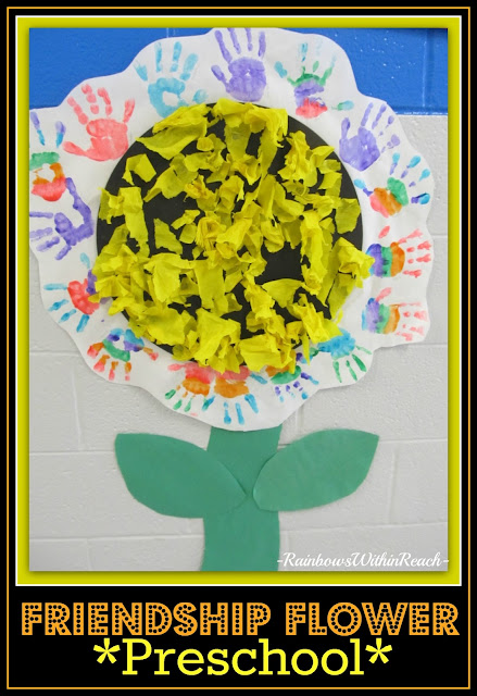 photo of: Class Mural Collaboration of Individual Handprint paintings creating a Sunflower in Bloom.
