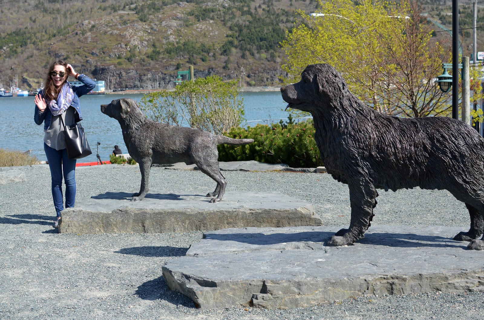 Chloe Gordon with Newfoundland dog statues in downtown St. John's