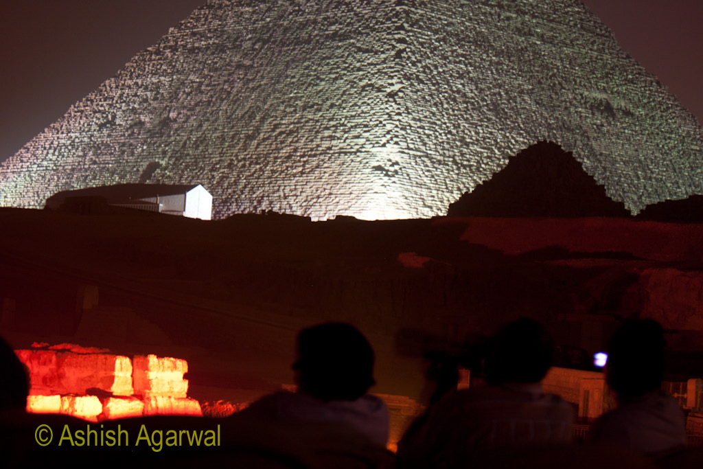 Tourists watching the Sound and Light show, with the lighted Great Pyramid in the background