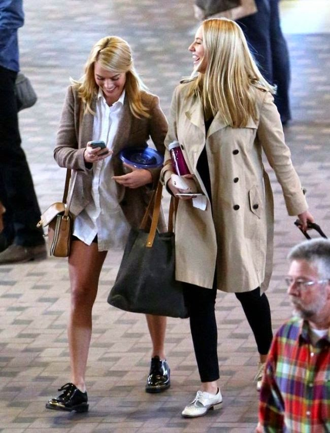 The actress, Margot Robbie was seen leaving the city in a street style as she walked with her female friend at the airport in Albuquerque, New Mexico on Friday, February 20, 2015.