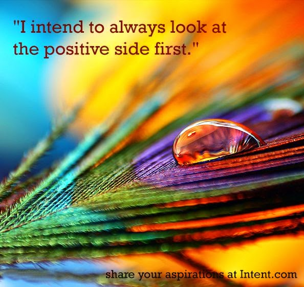 """I intend to always look at the positive side first."" Picture of a feather with a drop of water on it. intent.com"