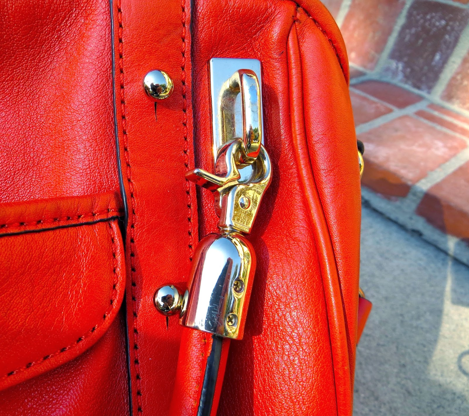 Rebecca Minkoff Cupid bag top handle clasps photo by Hello Handbag