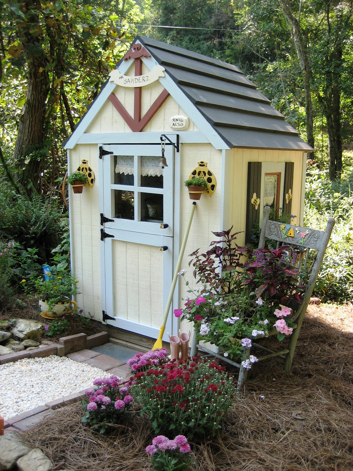 Whimsical cottage gardening sit with me in my garden for Cottage sheds