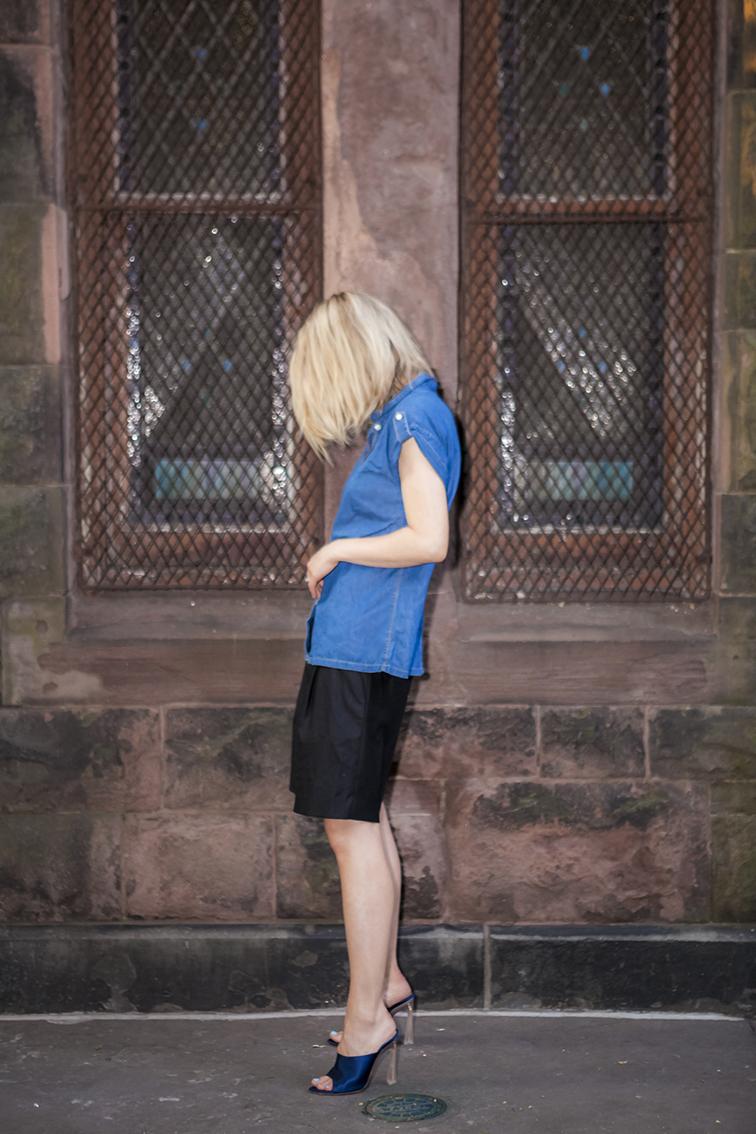 Zara denim top, Tibi oversized black dressy bermuda shorts, Nina Ricci satin slides mules