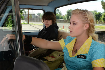 Maika Monroe and Brendan Meyer in The Guest
