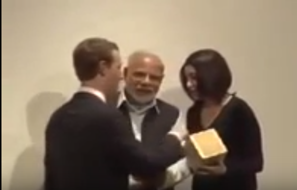 In the video shot at the Facebook headquarters, Modi is seen with Zuckerberg and Facebook Chief Operating Officer Sheryl Sandberg.  Modi, who has his back against the wall, moves Zuckerberg, who is blocking the cameras, aside. Zuckerberg is left looking visibly uncomfortable.