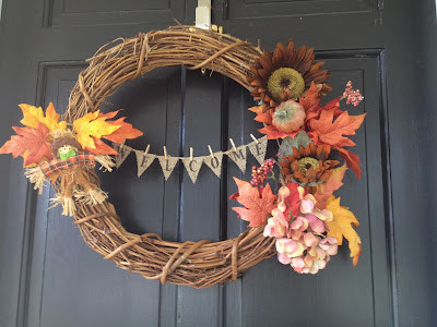 http://www.twoityourself.blogspot.com/2013/09/fall-wreath-makeover-with-mini-burlap.html