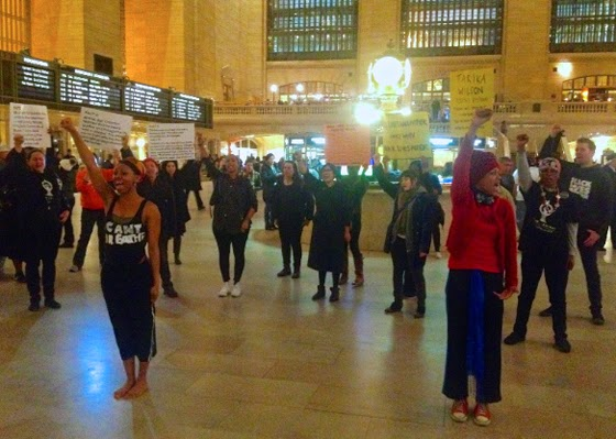 Artists for Justice and Shut It Down NYC staged a performance in Grand Central Station earlier this week. Credit:  Waging Nonviolence/Ashoka Jegroo. All rights reserved.