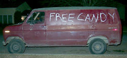 Van with 'free candy' painted on side'