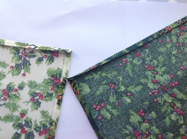 picture of corners of the fabric squares with the edges folded and pressed