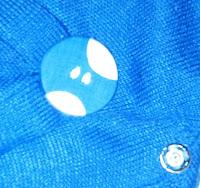 abrochar presilla con adorno de botón forrado