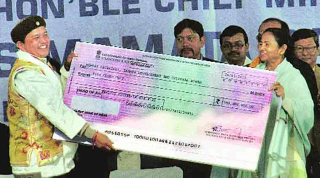 one of the Board chiefs receiving cheque from Mamata