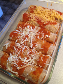 before baking, the meatless enchiladas are distinguished by only cheddar cheese. The rest have montery jack cheese