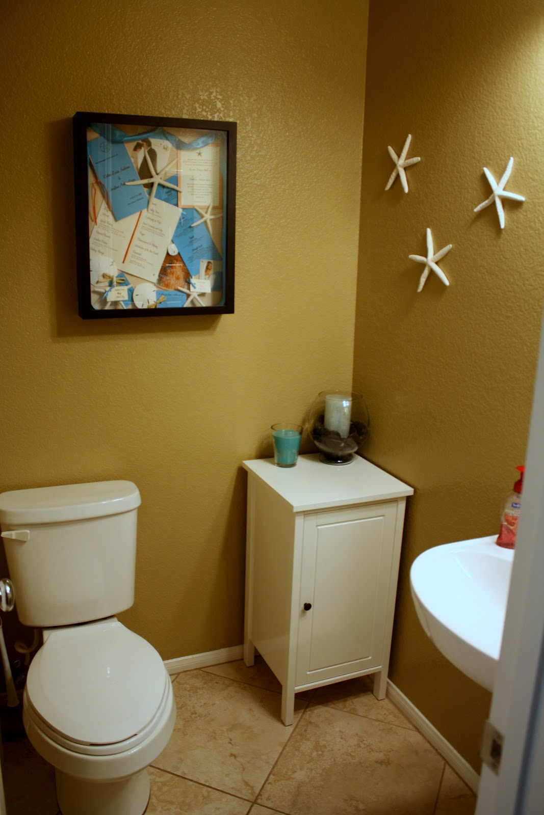Newlyweds next door town home tour stair decor half for Pics of bathroom decor