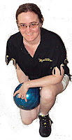 Cynthia Parkhill with bowling ball, team shirt and Dragonzilla shoes
