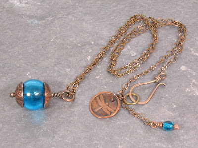 Hollow Blue Glass Bead with Copper Bead Caps on Brass Chain