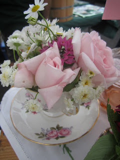 Soft pink roses in rosy bone china by Tuckshop Flowers
