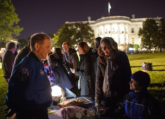 NASA Associate Administrator for the Science Mission Directorate John Grunsfeld, left, shows a spacesuit glove to an a student during the second White House Astronomy Night on Monday, Oct. 19, 2015. The second White House Astronomy Night brought together students, teachers, scientists, and NASA astronauts for a night of stargazing and space-related educational activities to promote the importance of science, technology, engineering, and math (STEM) education. Photo Credit: (NASA/Joel Kowsky)