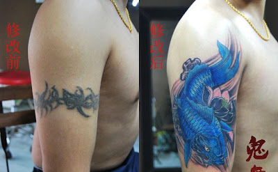 Blue Koi fish tattoo on the arm