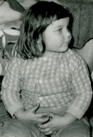 Vintage black and white photo of a chubby little girl from late 1950s.