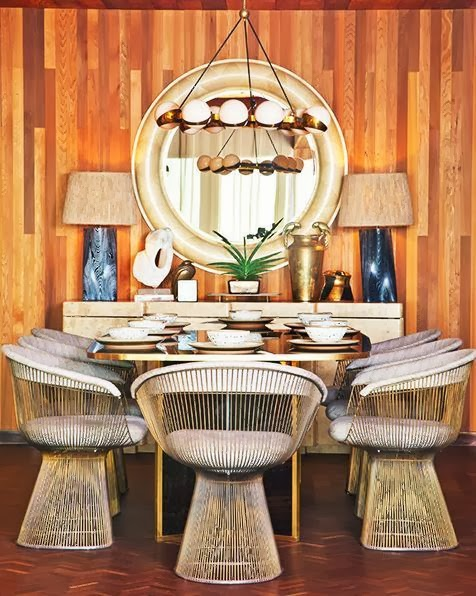 Kelly Wearstler wood panel dining room Platner chairs