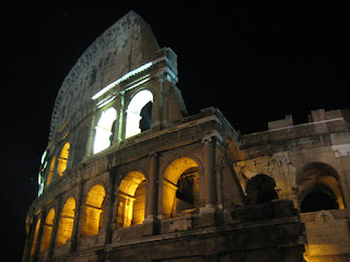 Colosseum lit at night.