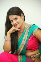 Anusha sizzling Pictures in half saree 060.JPG