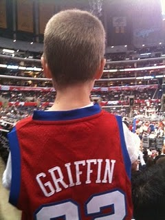 Jaden from behind in a basketball Jersey