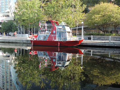 RED BOAT ON THE RIDEAU CANAL, OTTAWA