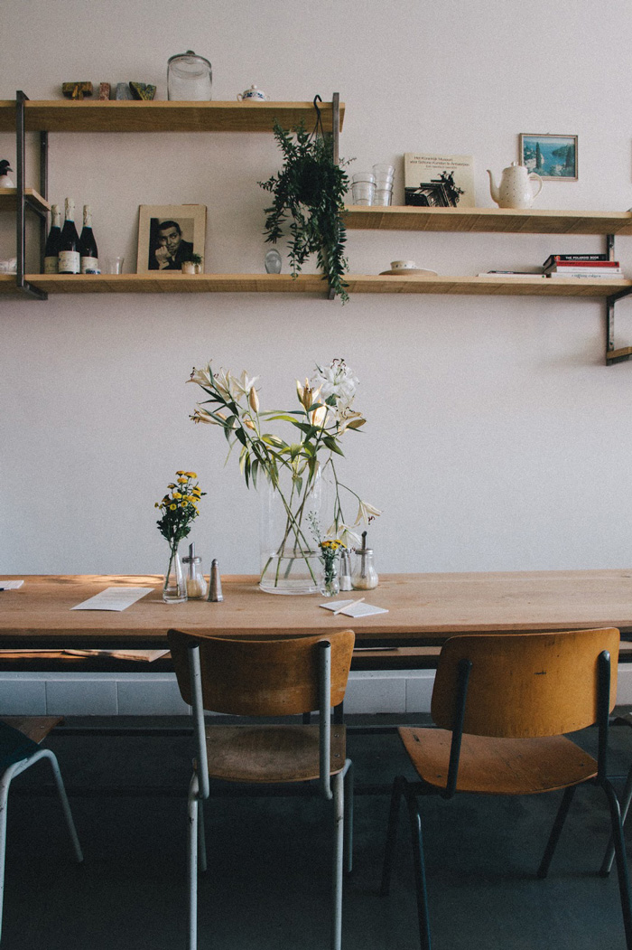 communal table and wooden shelves