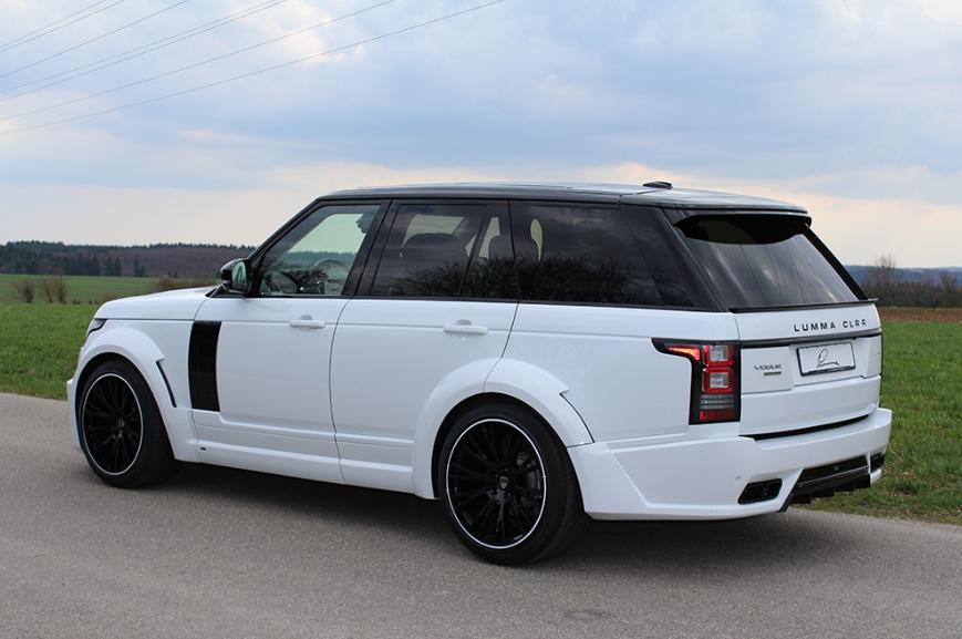 Белый Range Rover вид сбоку