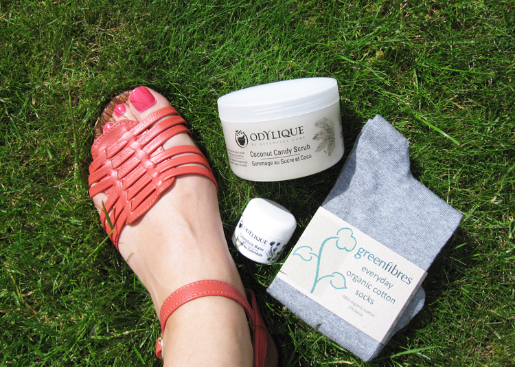 A picture of feet with Odylique organic beauty products