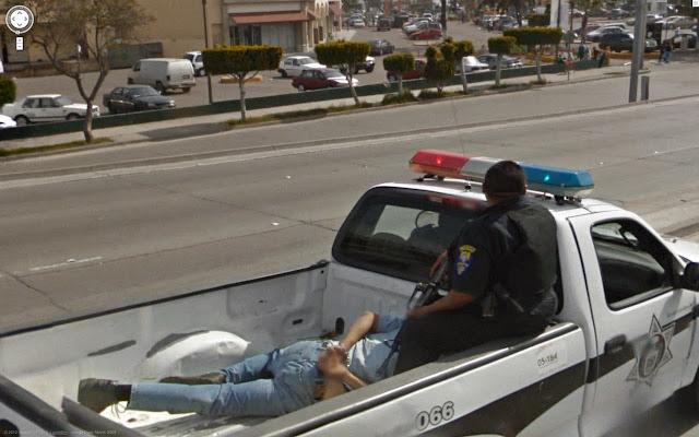 cop with a criminal in a van