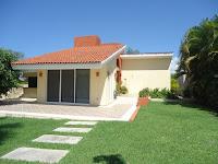 modelo de casa beige con tejado ocre un piso