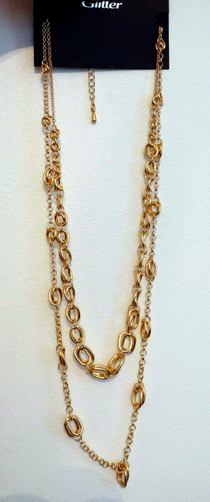 a picture of a long golden necklace